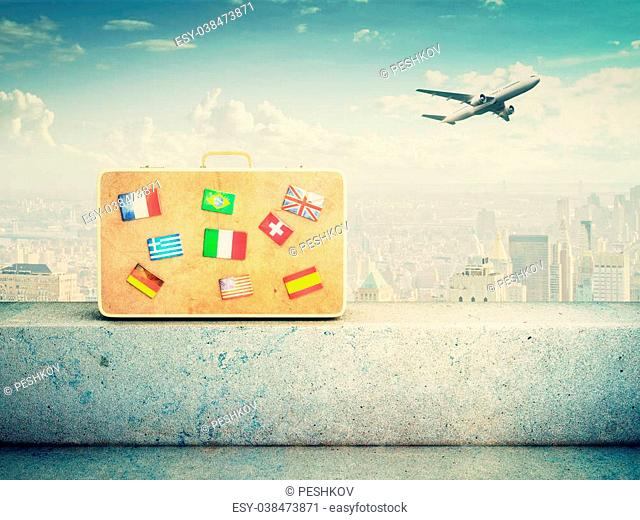 yellow leather suitcase with flag icons