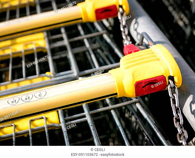 Shopping carts stay on parking, locking system on the coin