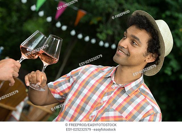 Group of Friends Enjoying Drink, Outdoor, serving rose wine