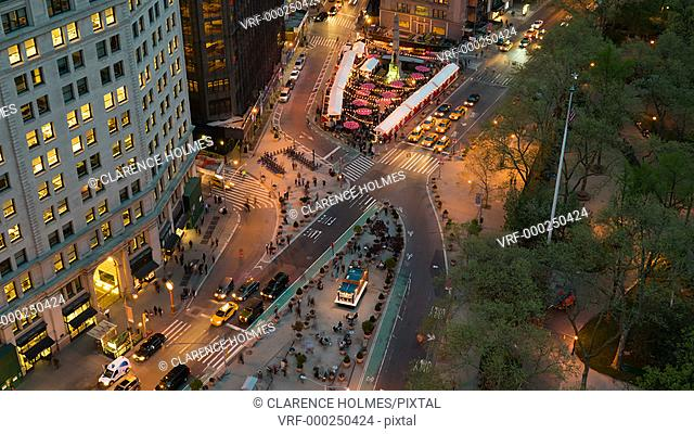 NEW YORK - MAY 7: (Time-lapse) Traffic and pedestrians move through Madison Square at the intersection of 5th Avenue and Broadway at 24th Street at twilight on...