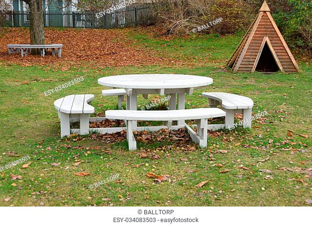one park bench with a table in the mittle where you can eat