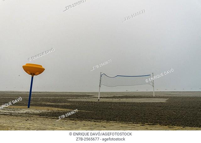A net volley view with fog in Playa Lisa beach, Alicante, Spain