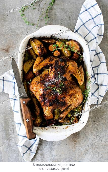 Roast chicken with potatoes and thyme