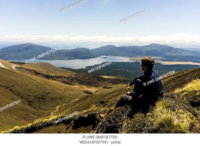 New Zealand, Tongariro National Park, hiker looking to Mangatepopo Valley