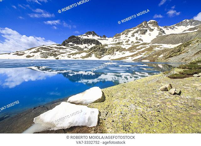 Ice blocks on the shore of alpine lake Lej da la Tscheppa during thaw, St. Moritz, Engadin, canton of Graubunden, Switzerland