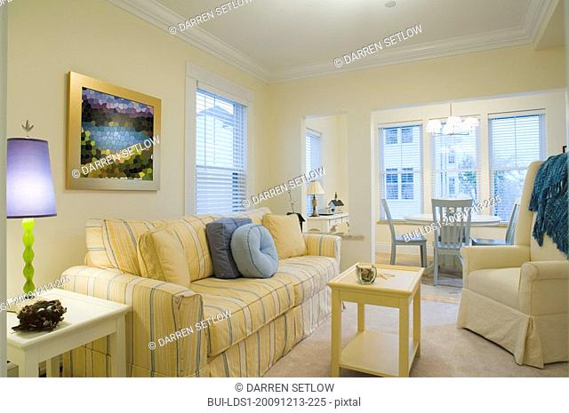 Yellow living room with dining nook