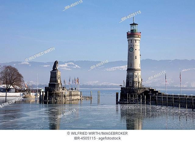 Harbor entrance in winter, Bavarian Lion, New Lighthouse, Lindau, Lake Constance, Bavaria, Germany