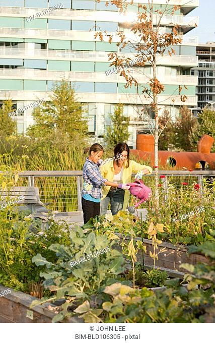 Japanese mother and daughter gardening together