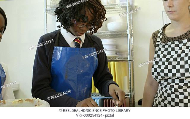 Schoolgirls and teacher in catering