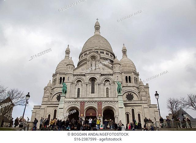 Paris, Montmartre, France - Tourists in front of Sacre-Coeur Basilica