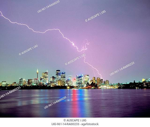 Lightning over the city and harbor. Sydney, New South Wales, Australia. (Photo by: Auscape/UIG)