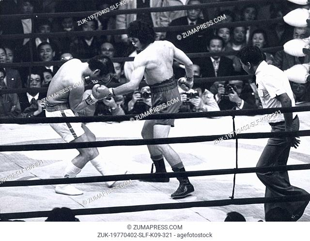 Apr 02, 1977 - Tokyo, Japan - SENSAKU MUAN SURIN (R) delivers the knock out punch to YOUJI SHIMATSU for the World Welter Weight Championship