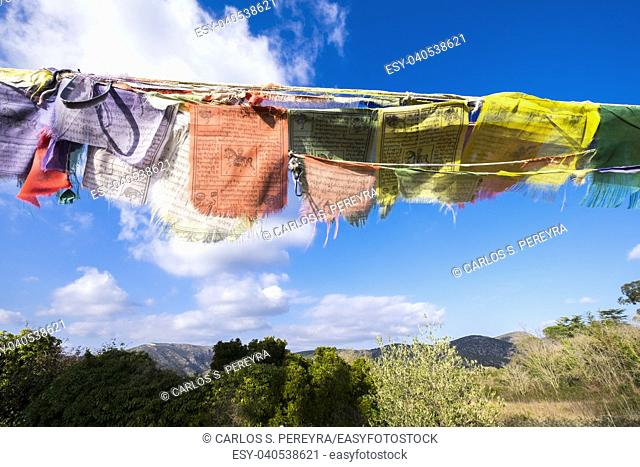 Low angle view of prayer flags Buddhism religion in Garraf in Barcelona Catalonia Spain