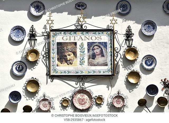 Spain, Andalusia, Granada, World Heritage Site, Sacromonte Gipsy district, Gipsy pride with display of faith and tableware