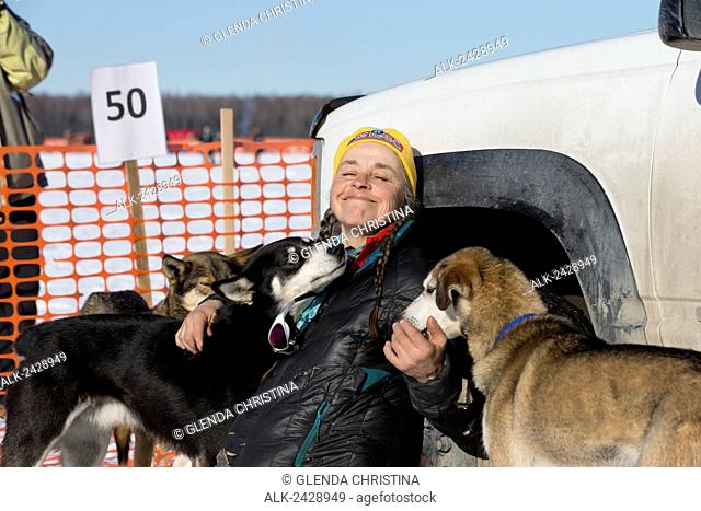 Canadian Iditarod musher #50 Marcelle Fressineau playing with her dog team just before the 2014 Alaska Iditarod Race restart, Willow, Alaska