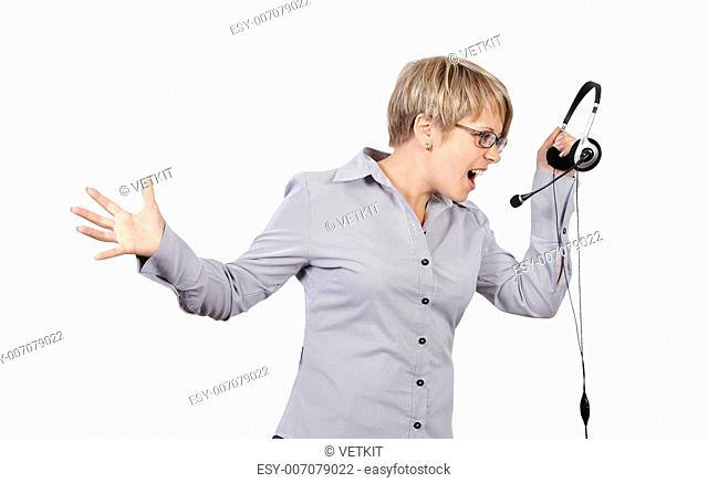 angry shouts into microphone operator