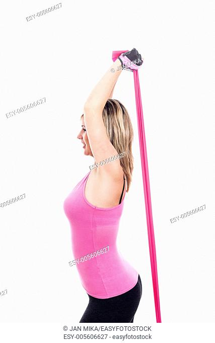 Young sportswoman stretching rubber band, isolated on white background