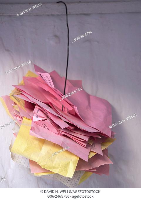 Stack of papers attached on metal cable in Udaipur, Rajasthan, India