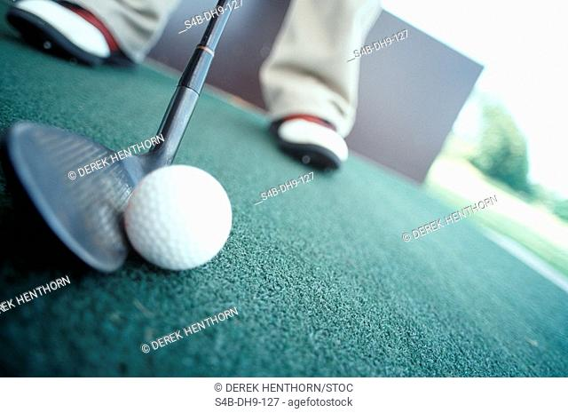 Person playing golf part of, low angle view