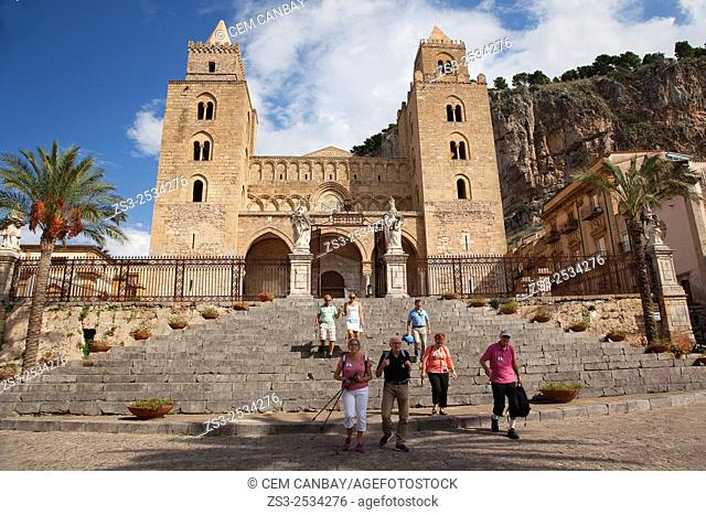 Tourists going down the stairs at the Piazza Duomo with the Cathedral at the background, Cefalu, Sicily, Italy, Europe
