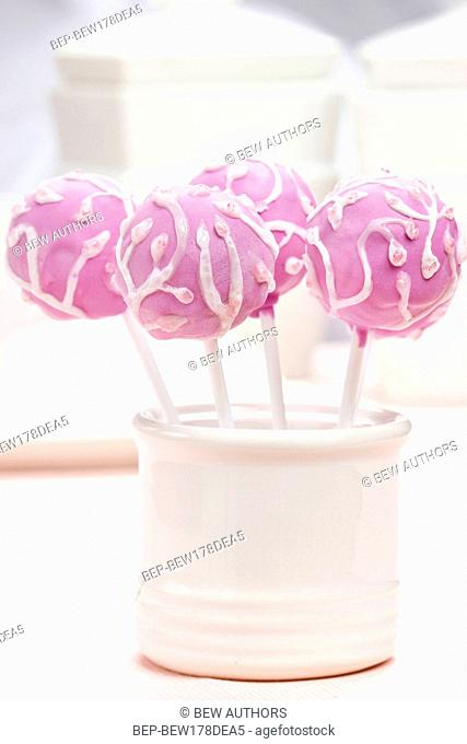 Lilac cake pops decorated lavishly decorated with icing. Selective focus