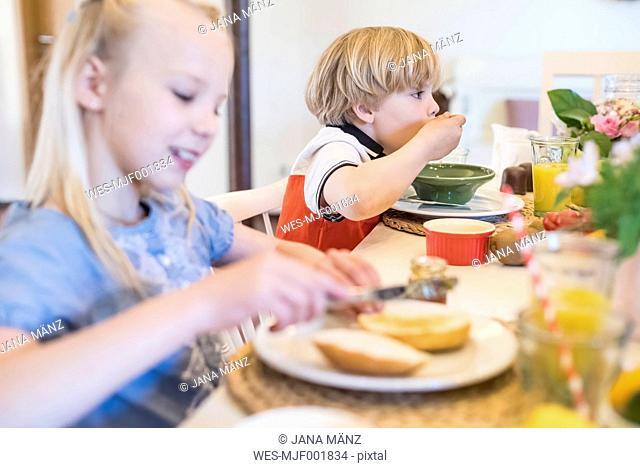Boy and girl having breakfast