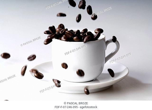 Close-up of coffee beans pouring in a cup