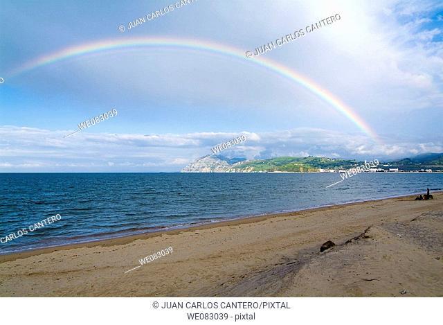 Rainbow over beach, Laredo, Cantabria, Spain