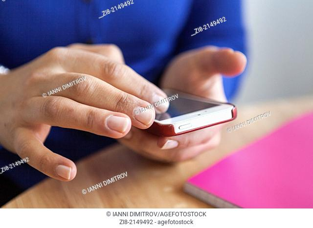 Woman browsing the web on a smart phone-close-up