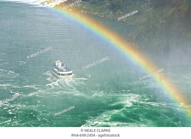 Maid of the Mist tour excursion boat under the Horseshoe Falls waterfall with rainbow at Niagara Falls, Ontario, Canada, North America