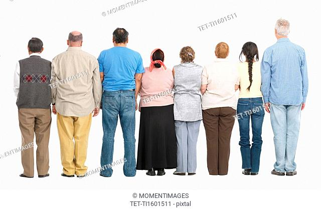 Rear view of people standing in a row