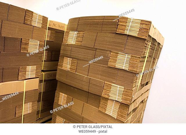 New flat cardboard boxes bundled together on wooden pallers