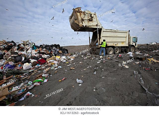 Smith's Creek, Michigan - A truck dumps garbage at St  Clair County's Smith's Creek Landfill  Landfill operators collect methane from decaying refuse and burn...