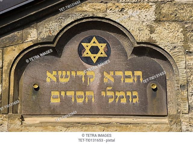 Close up of old synagogue sign
