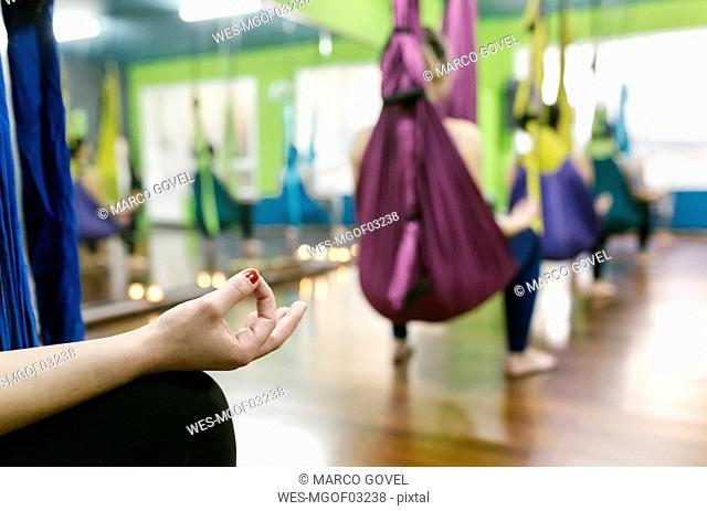 Group of women preparing for a class of aerial yoga