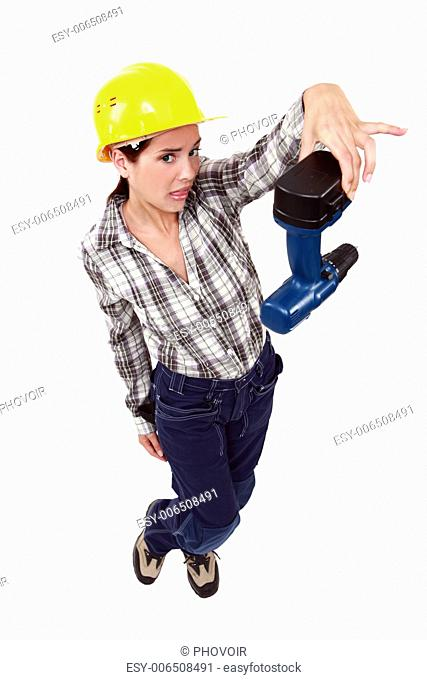 Confused woman holding drill