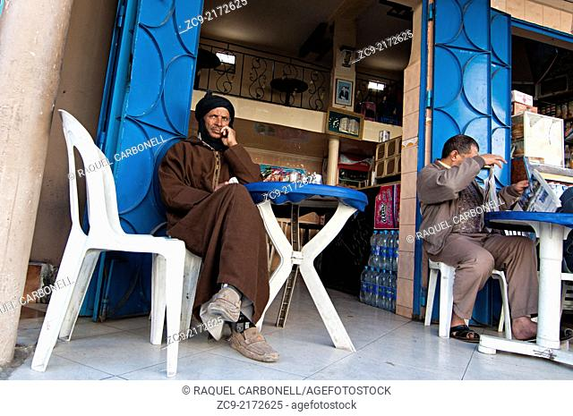 Men having a tea pot at a restaurant in the ancient medina, Tiznit, Morocco