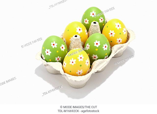 Decorated Easter eggs in an egg box