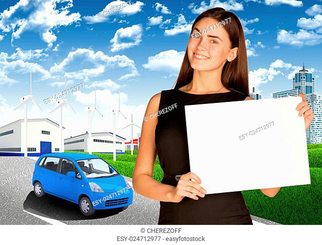 Businesswoman holding paper sheet. Road, skyscrapers and industrial area as backdrop