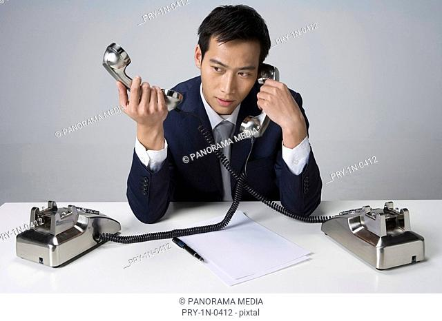 Young man on phones