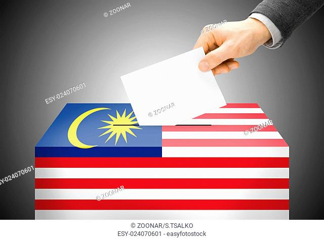 Voting concept - Ballot box painted into national flag colors - Malaysia