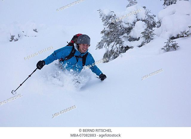 Skiers while deep-snow skiing, ski tour Rotwand, Mangfall Mountains, Bavarian Alps, Bavaria, Germany
