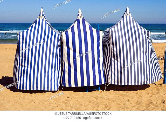 Booths shade on the beach. Spain, Basque Country, province of Guipuzcoa, Zarautz