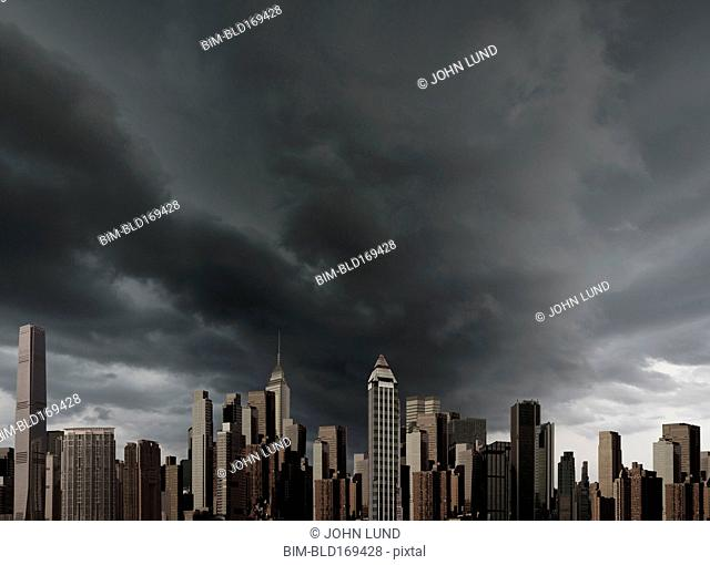City skyline under storm clouds
