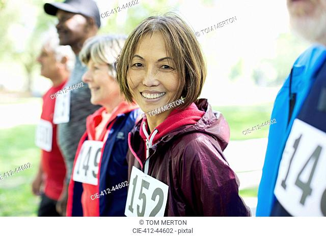 Portrait smiling, confident active senior woman at sports race starting line