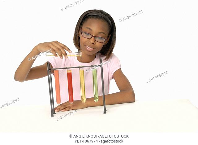 Female student doing a science experiment