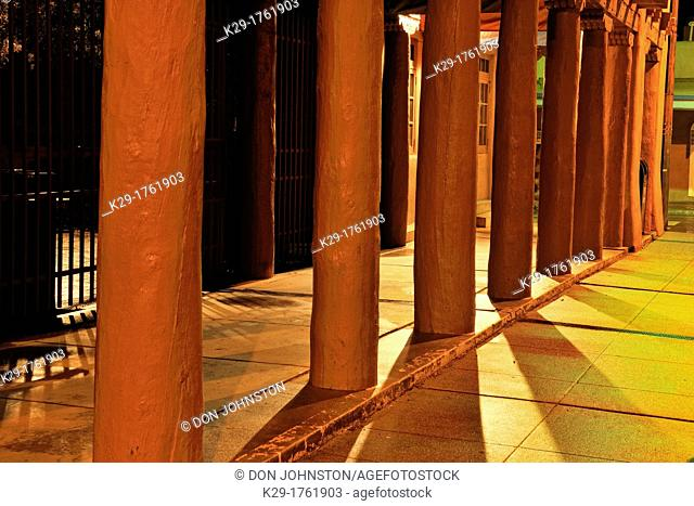 Downtown Santa Fe in winter- Columns at nighttime with shadows, Santa Fe, New Mexico, USA