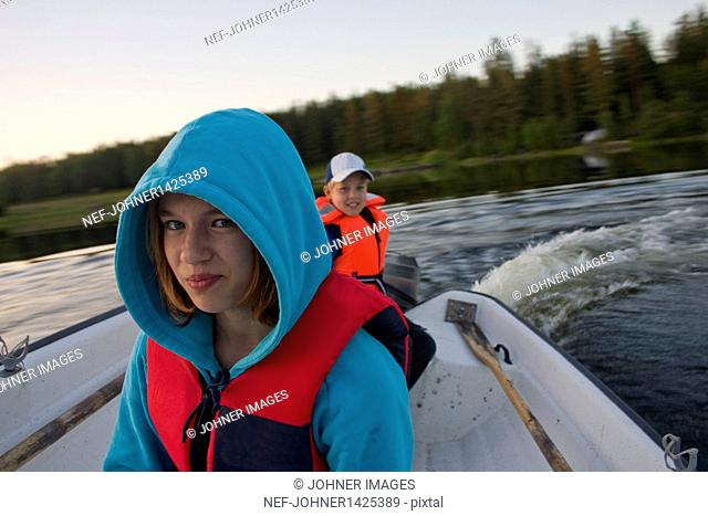 Girl and boy on speed boat