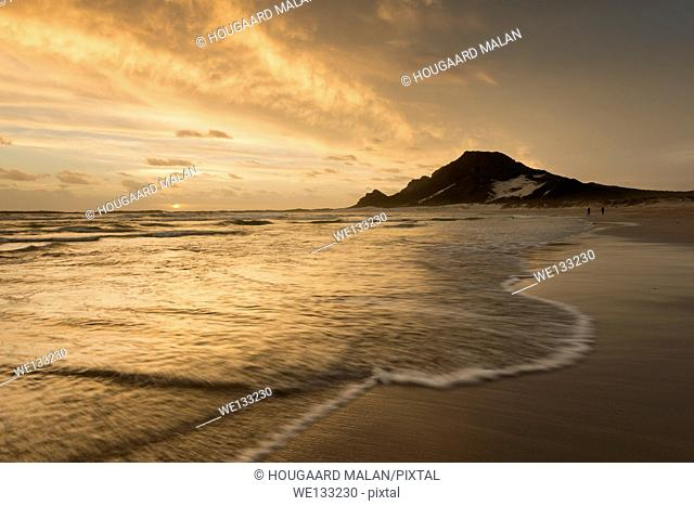 Landscape photo of a colourful sunset on a beach. Bettys Bay, Western Cape, South Africa
