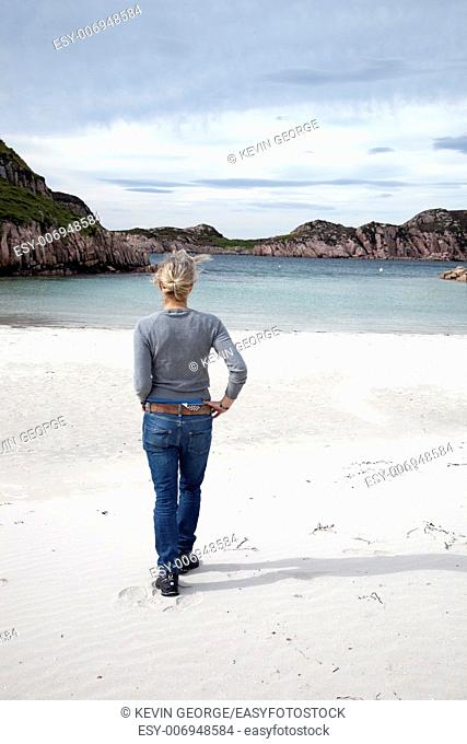 Young Standing Woman on Beach on Isle of Mull; Scotland;